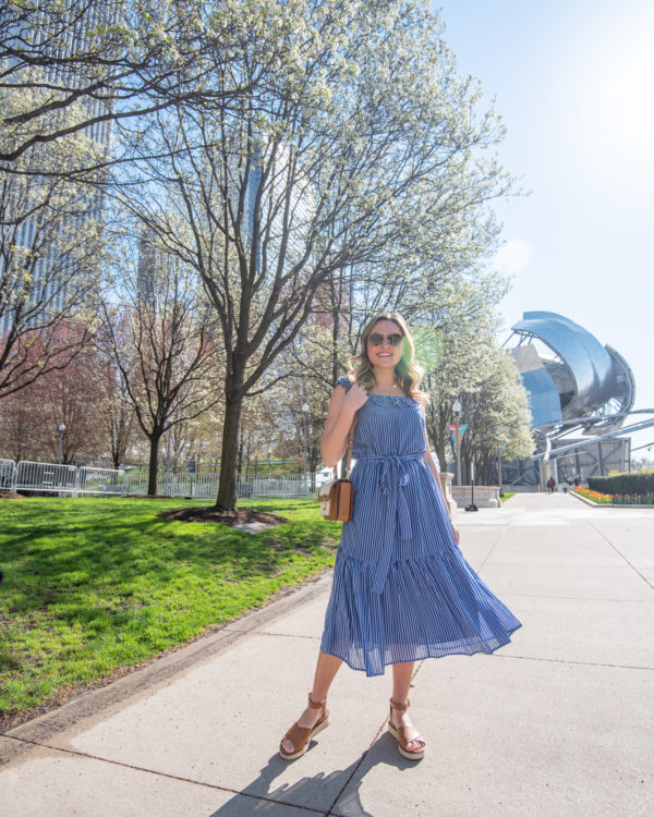 Chicago fashion blogger Jessica Sturdy of Bows & Sequins styling a feminine ruffled spring midi dress in Millennium Park