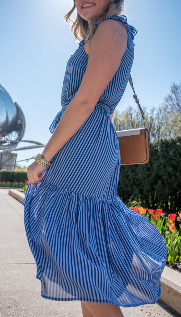 Chicago stylist Jessica Sturdy of Bows & Sequins wearing a blue and white railroad stripe midi dress.