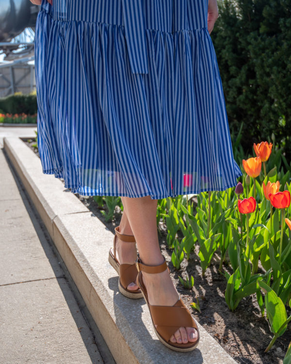 Chicago fashion blogger Bows & Sequins styling a railroad stripe midi dress with leather espadrille flatform sandals in front of colorful tulips.