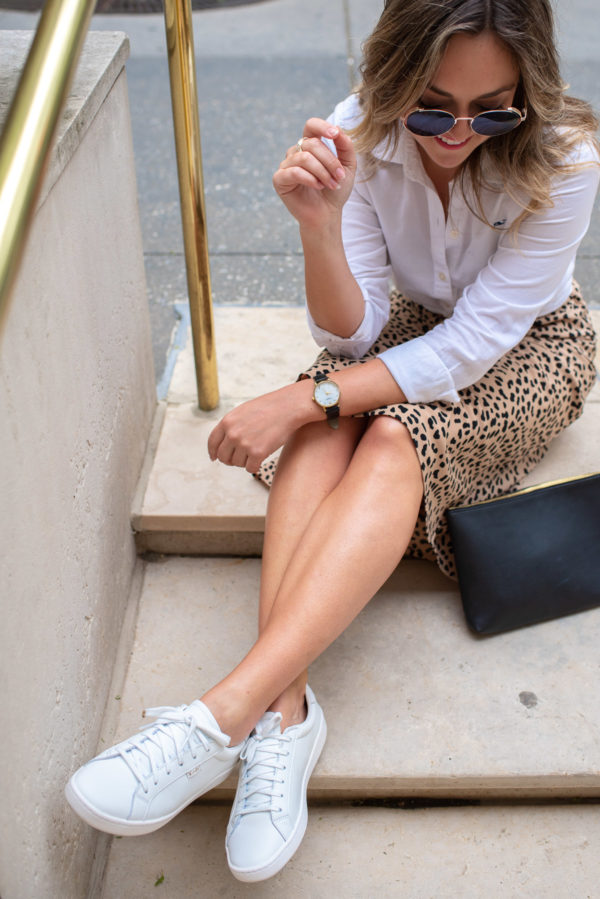 Fashion blogger Bows & Sequins styling classic white Keds sneakers.