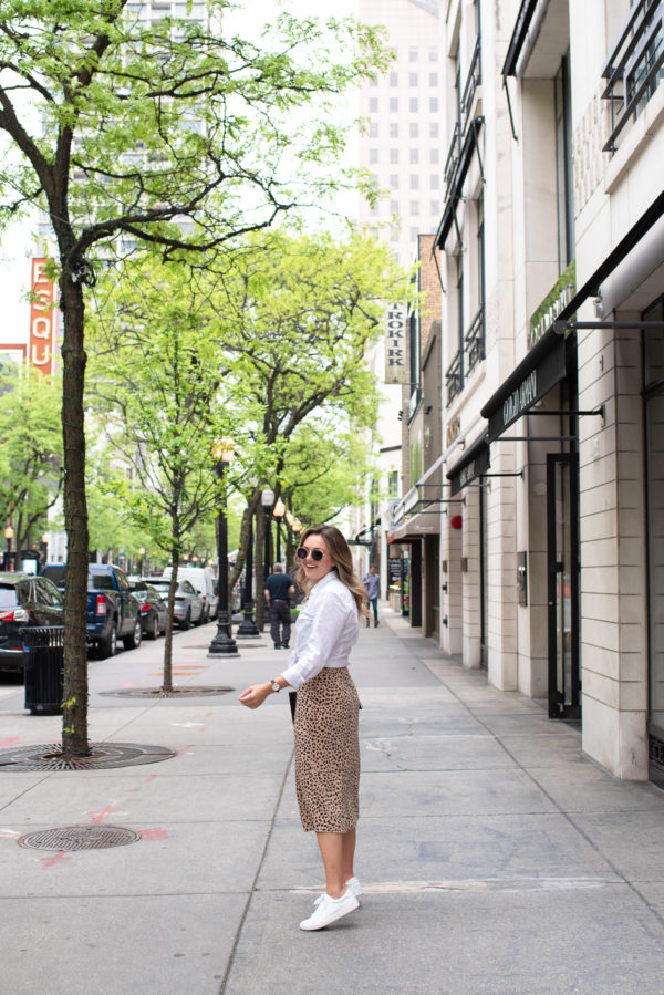 Jessica Sturdy of Bows & Sequins on Oak Street in Chicago's Gold Coast wearing a leopard skirt and white sneakers.