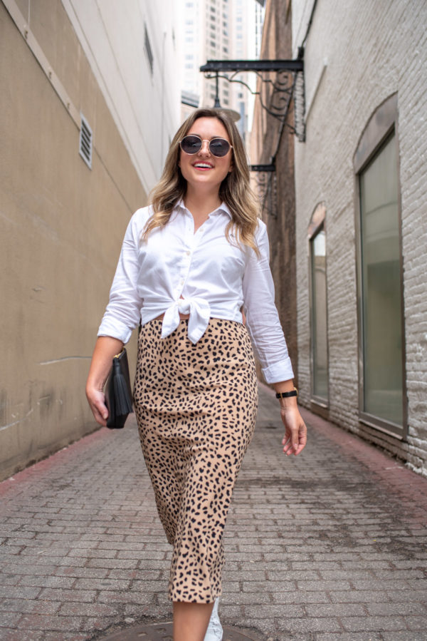 Chicago blogger Jessica Sturdy of Bows & Sequins wearing a white collared shirt with a leopard skirt.
