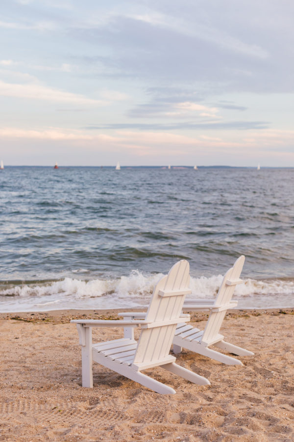 White Adirondack Chairs at Wee Burn Beach Club in Connecticut at Sunset