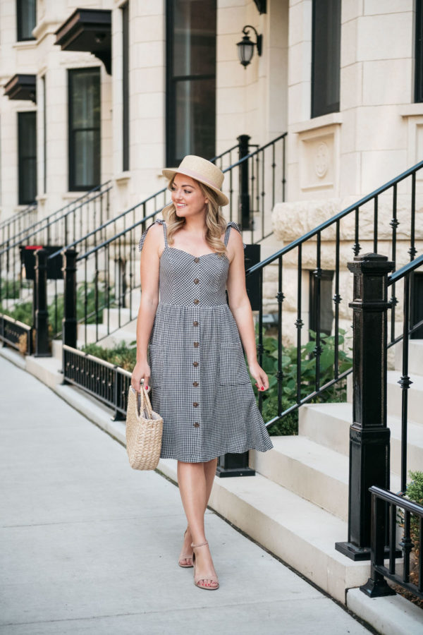 Chicago fashion and lifestyle blogger Bows & Sequins wearing a gingham dress with blush pink heels and a straw hat.