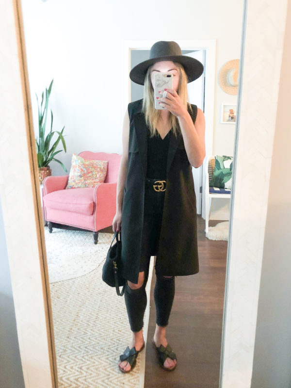 Fashion blogger Jessica Sturdy of Bows & Sequins wearing a sleeveless trench coat with a Janessa Leone hat and a Gucci belt.