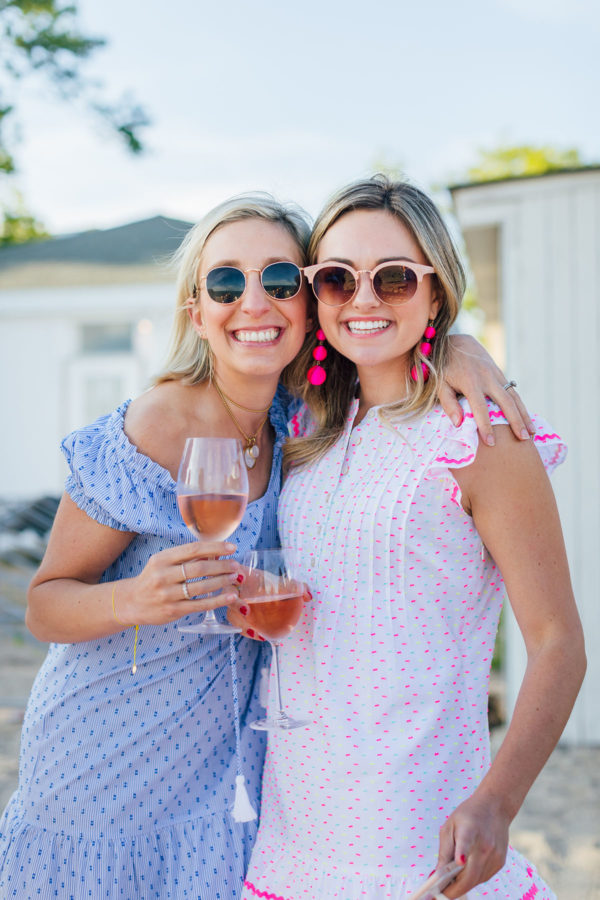 Preppy fashion and lifestyle bloggers Julia Dzafic of Lemon Stripes and Jessica Sturdy of Bows & Sequins at Wee Burn Beach Club wearing Sail to Sable Dresses.