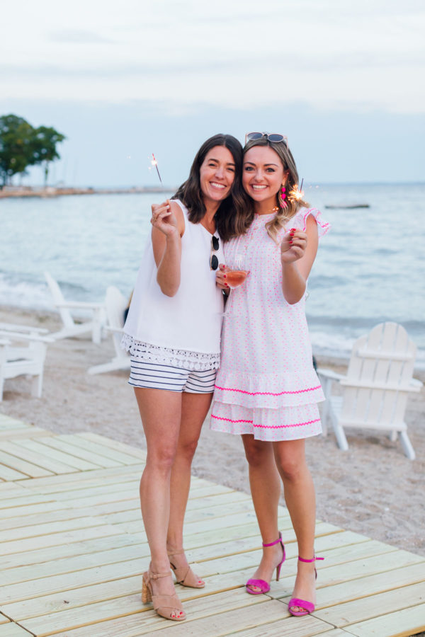 Liz Adams and Jessica Sturdy with sparklers at Sail to Sable's Set Sail Summer Blogger Beach Party.