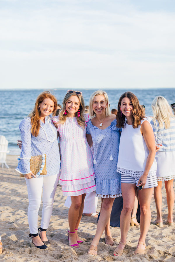 Preppy fashion bloggers Mackenzie Horan of Design Darling, Jessica Sturdy of Bows & Sequins, Julia Dzafic of Lemon Stripes, and Liz Adams of Hello Adams Family at Sail to Sable's Summer Party at Wee Burn Beach Club in Connecticut