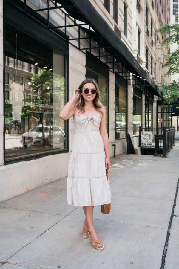 Bows & Sequins styling a striped tiered sundress.