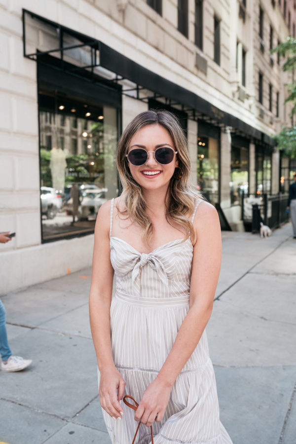Chicago lifestyle influecer Jessica Sturdy of Bows & Sequins styling a neutral tie-front dress.