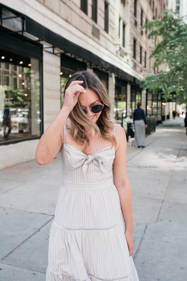 Fashion and beauty blogger Jessica Sturdy wearing a tie-front pinstriped dress.