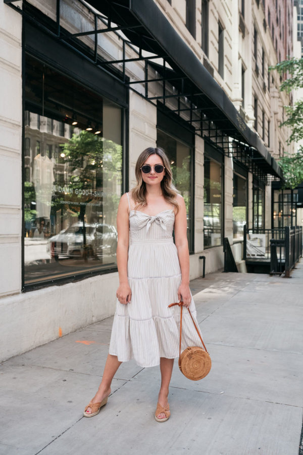 Chicago fashion blogger Jessica Sturdy of Bows & Sequins wearing a tiered midi dress on Delaware St in the Gold Coast.