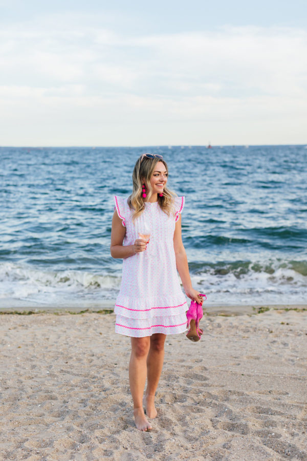 Jessica Sturdy wearing a Sail to Sable Funfetti Ruffled Dress at Wee Burn Beach Club in Connecticut.