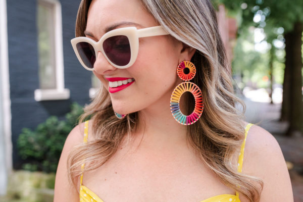 Fashion blogger Bows & Sequins styling BaubleBar rainbow raffia earrings with neutral sunglasses by Boden.