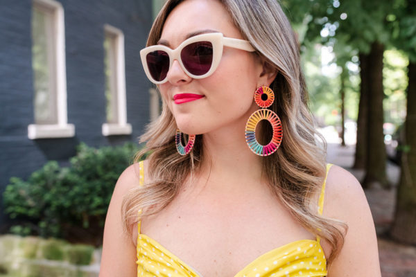 Chicago fashion blogger Bows & Sequins wearing colorful BaubleBar earrings and retro sunglasses from Boden.