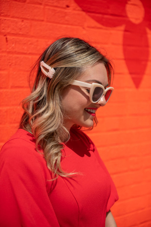 Chicago fashion and beauty blogger Bows & Sequins wearing a pearl barrette hair clip with white sunglasses.