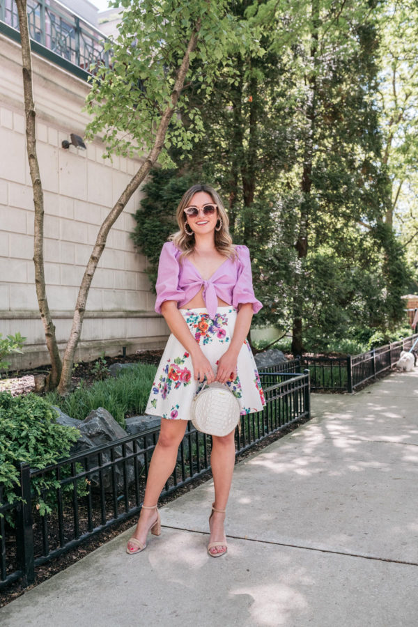 Chicago fashion and beauty blogger Bows & Sequins styling a floral fit and flare skirt.