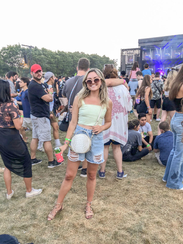 Chicago blogger Jessica Sturdy at Lollapalooza Music Festival wearing a green gingham crop top from Aritzia with Cotton-On high rise shorts, and Loeffler Randal wrap sandals.