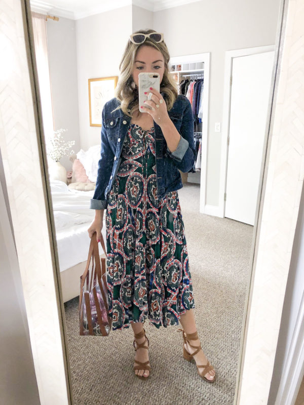 Chicago personal stylist Jessica Sturdy of Bows & Sequins wearing a Delfi Collective pleated paisley print bustier dress, a dark denim jean jacket, a Loeffler Randall clear and cognac leather tote, and lace-up sandals for an easy summer fall transition outfit.