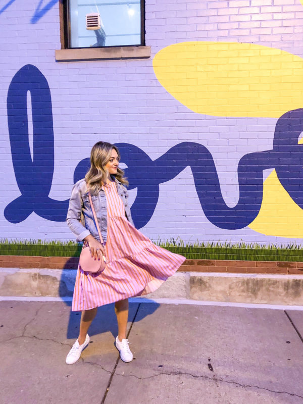 Chicago blogger Bows & Sequins wearing an MDS Stripes orange and pink sleeves peasant dress with white Keds sneakers, a pink Kate Spade Rococo Pink Andi Canteen Bag, and a jean jacket.