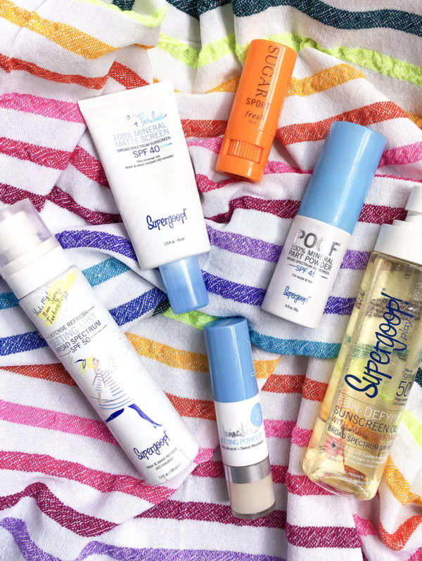 Beauty blogger Bows & Sequins shares reviews of Supergoop SPF Setting Mist, Tinted Poreless Suncreen, Mineral Powder Suncreen, POOF Hairline Suncreen Powder, Age Defying Oil, and Fresh Sport Chapstick