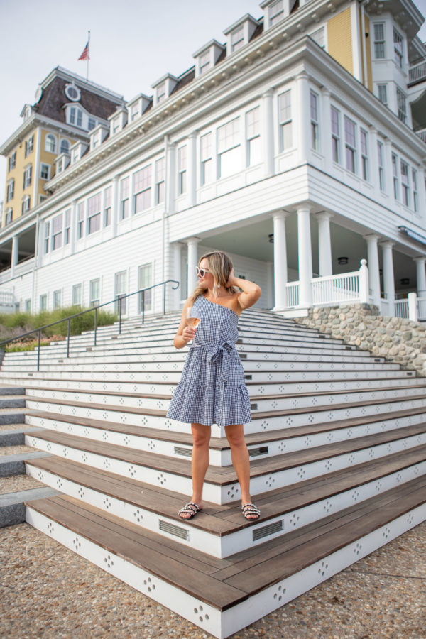 Preppy lifestyle blogger Bows & Sequins wearing a Vineyard Vines gingham one-shoulder dress at Ocean House in Rhode Island.