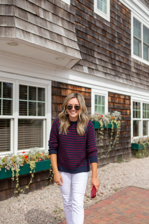 Jessica Sturdy of Bows & Sequins wearing a blue and red striped crewneck sweater by Vineyard Vines in Watch Hill, Rhode Island.