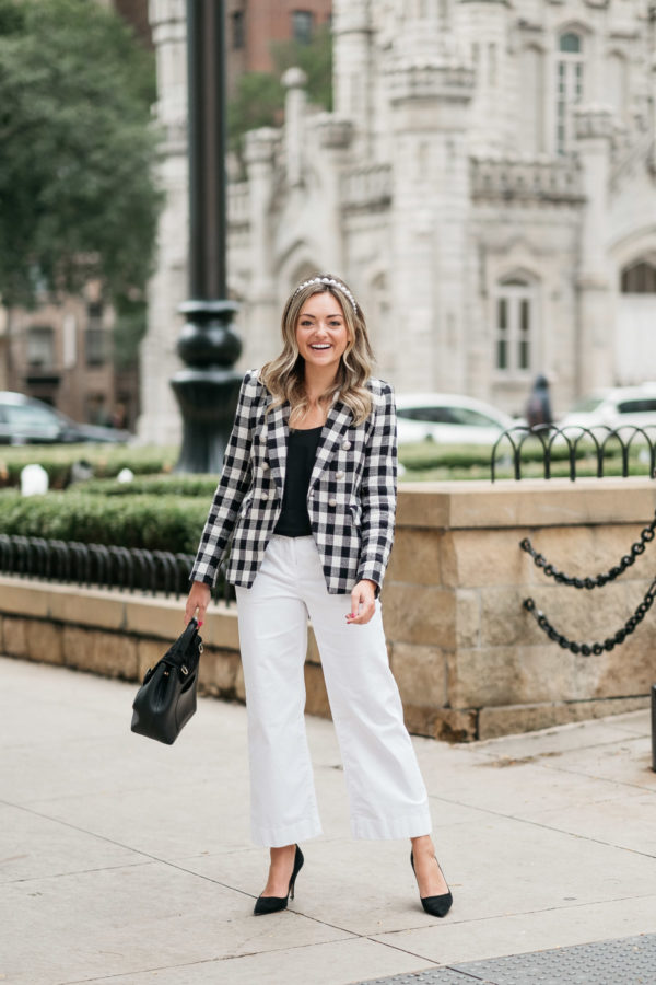 Chicago wardrobe consultant Jessica Sturdy wearing a Veronica Beard blazer by the Water Tower.