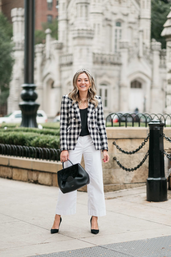 Chicago personal stylist Jessica Sturdy wearing a Veronica Beard blazer with white cropped pants by the Water Tower.