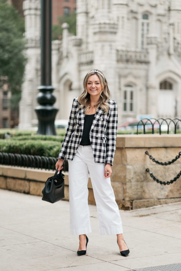 Chicago personal shopper Jessica Sturdy wearing a gingham blazer and white wide leg pants for an office-appropriate look.