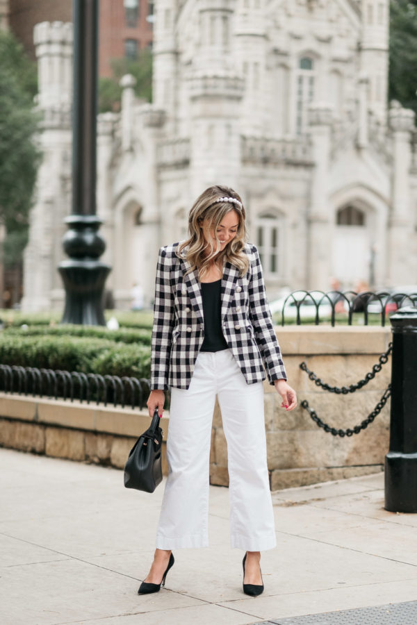 Chicago lifestyle blogger Jessica Sturdy of Bows & Sequins styling a gingham blazer with white wide leg pants for the office.