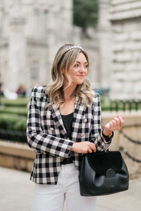 Chicago influencer wearing a Veronica Beard Miller Dickey Jacket with a pearl headband.