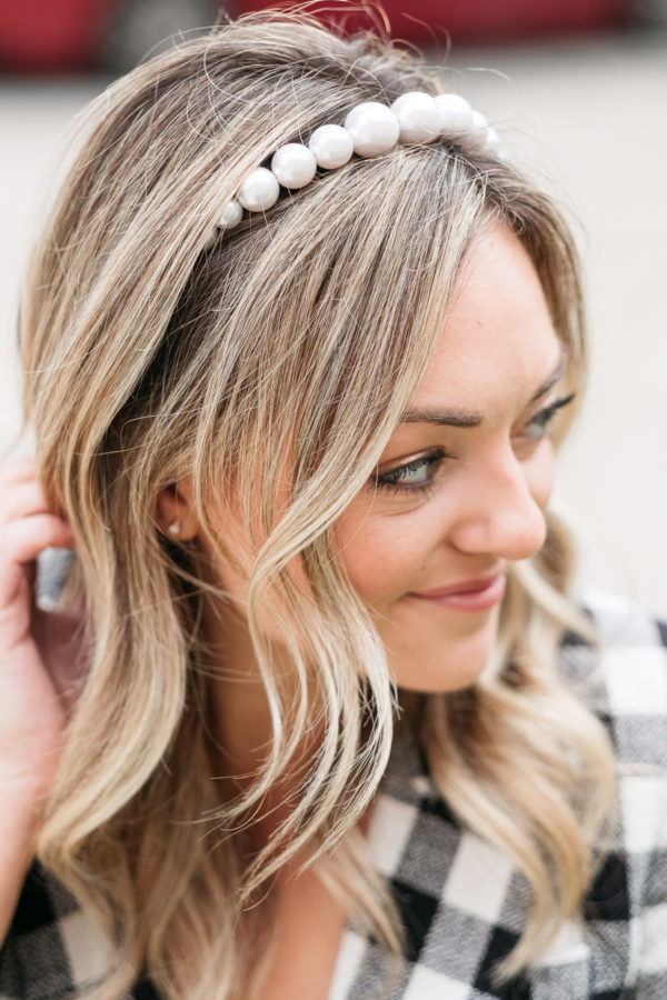 Fashion blogger Jessica Sturdy showing how to style a pearl headband.