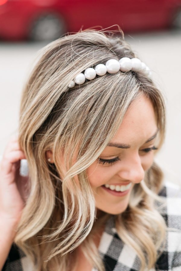 Fashion influencer Jessica Sturdy styling a pearl headband, one of fall's must-have hair accessories.