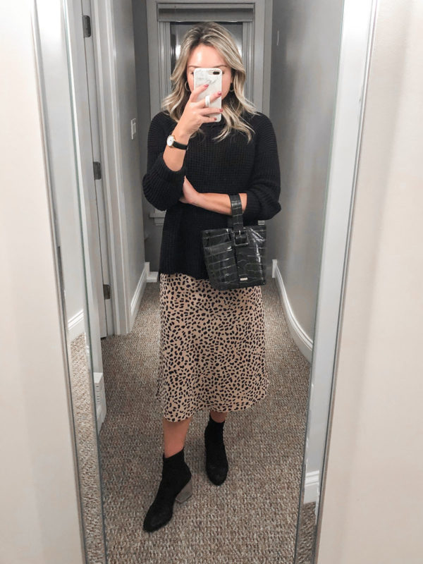 Fashion blogger Jessica Sturdy of Bows & Sequins wearing a 525 America Turtleneck, Leopard Midi Skirt, Sock Booties, and a Brahmin Bag