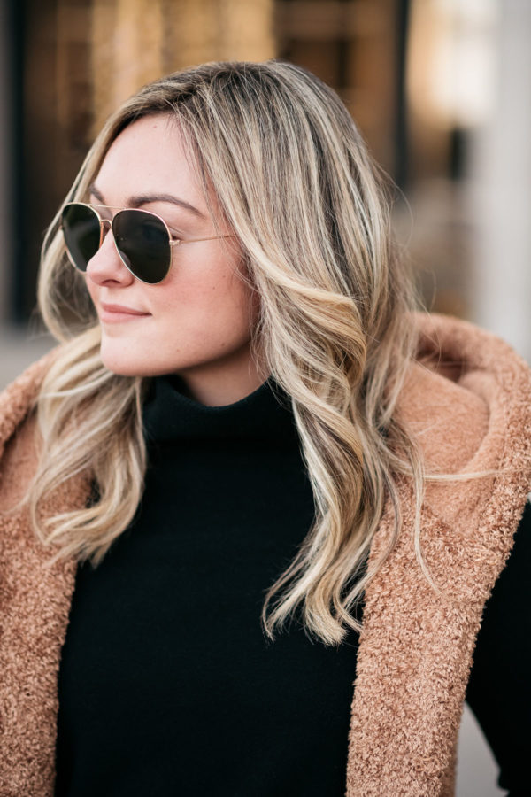 Chicago beauty blogger Jessica Sturdy with loose curls, a fresh haircut, and blonde highlights from RMCM Salon in the Gold Coast.