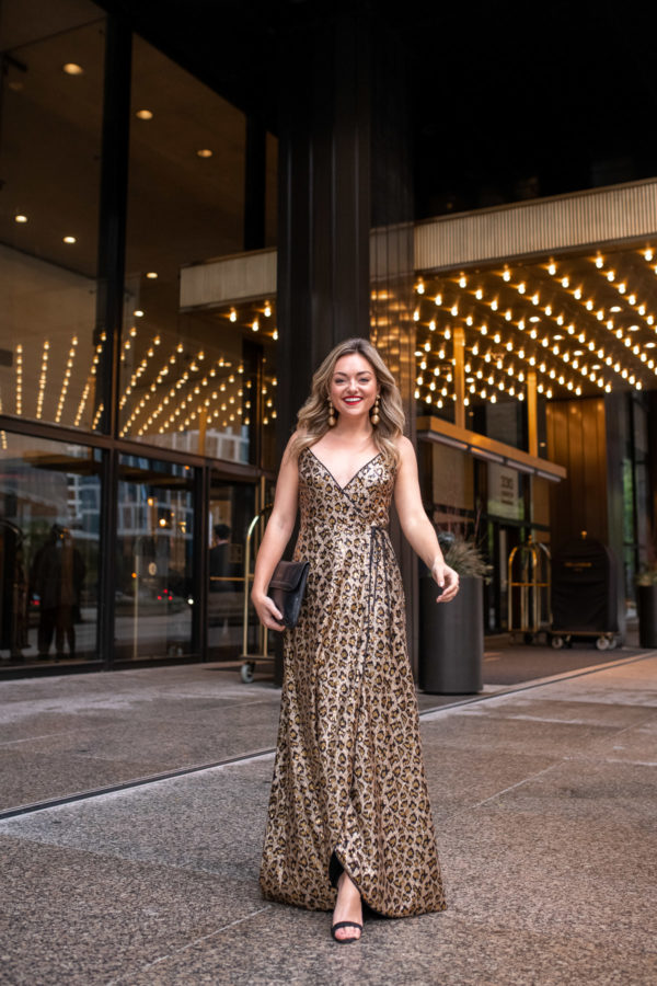 Chicago lifestyle influencer Bows & Sequins wearing a floor length sequin leopard print dress for New Years Eve.