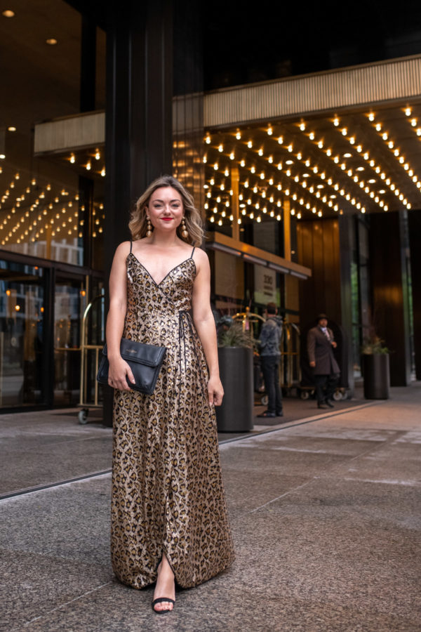 Fashion and lifestyle blogger styling a black tie leopard print dress for a holiday party.