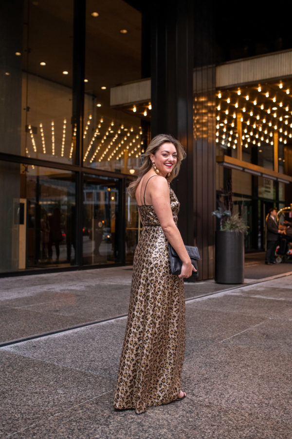 Chicago fashion influencer Bows & Sequins styling a floor length sequin dress for the holidays.