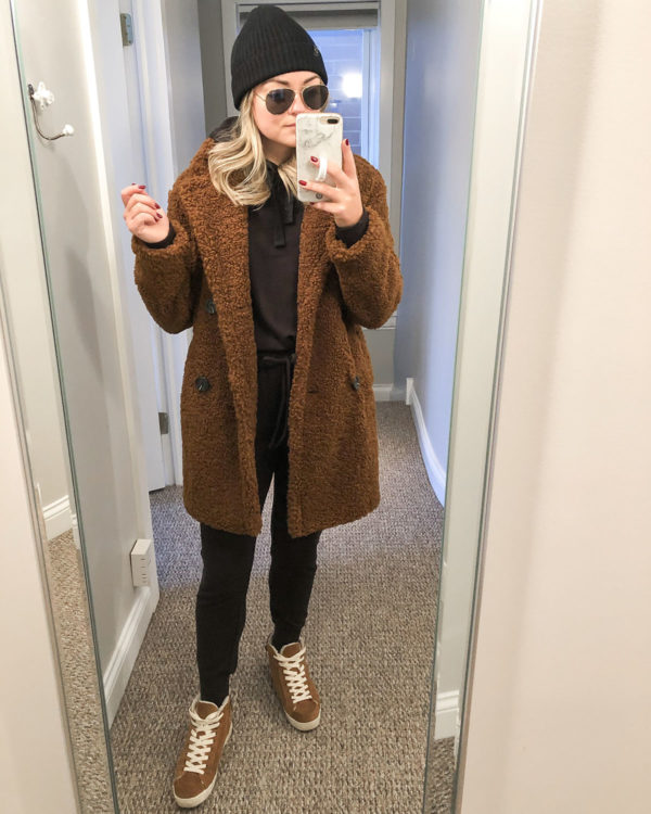 Fashion blogger wearing brown teddy coat with Vineyard Vines joggers and suede sneakers.
