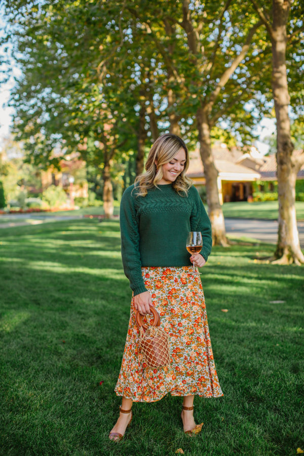 Lifestyle blogger Jessica Sturdy wearing a floral midi skirt at Vintners Inn Resort in Santa Rosa, California.