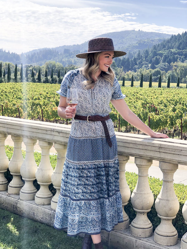 Travel blogger Jessica Sturdy wearing a chic fall outfit at Ferrari-Carano Vineyards in Sonoma County, California.