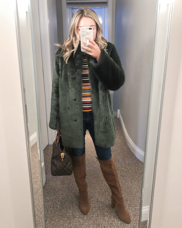 Chicago stylist wearing green faux fur coat with cognac suede knee high boots.