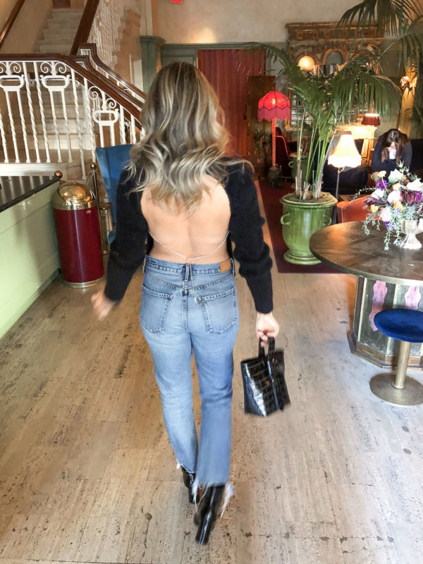 Style influencer Bows & Sequins wearing a Revolve h:ours open back rhinestone sweater with Citizens of Humanity Charlotte Crop Jeans and a Brahmin bag.