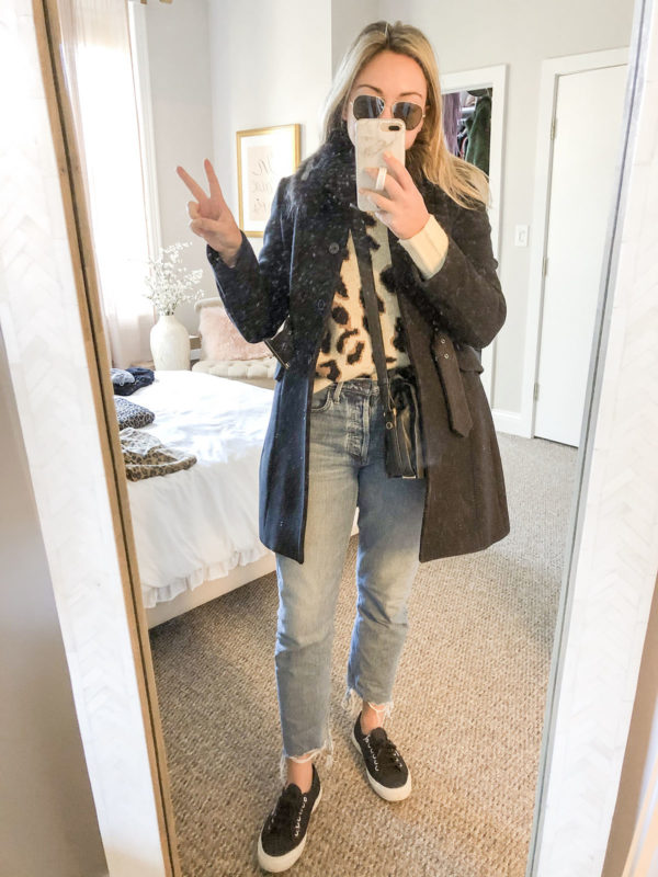 Blogger styling leopard sweater with mom jeans and Superga sneakers.