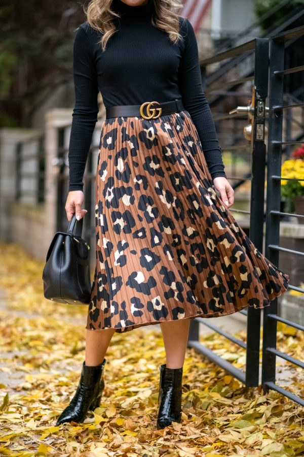 Chicago fashion blogger styling a pleated leopard skirt.