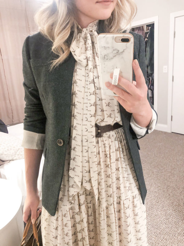 Preppy fashion blogger styling a Ralph Lauren horse printed tie-neck dress with a green blazer.