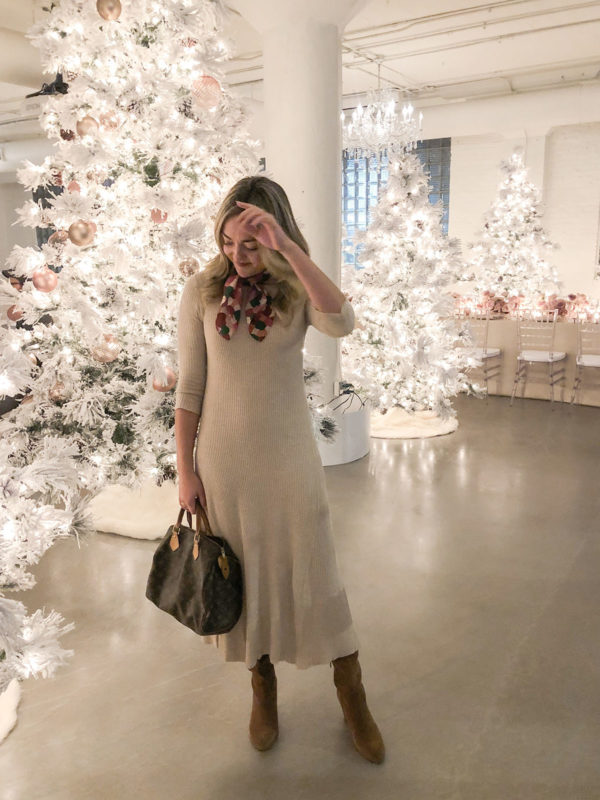 Blogger wearing ribbed sweater dress and neck scarf at Rachel Parcell holiday Christmas event in Chicago.