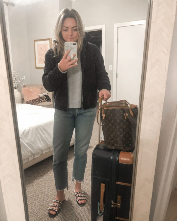 Casual travel day outfit: Sherpa bomber, Citizens of Humanity croppedjeans, and a Bric's Bellagio suitcase.