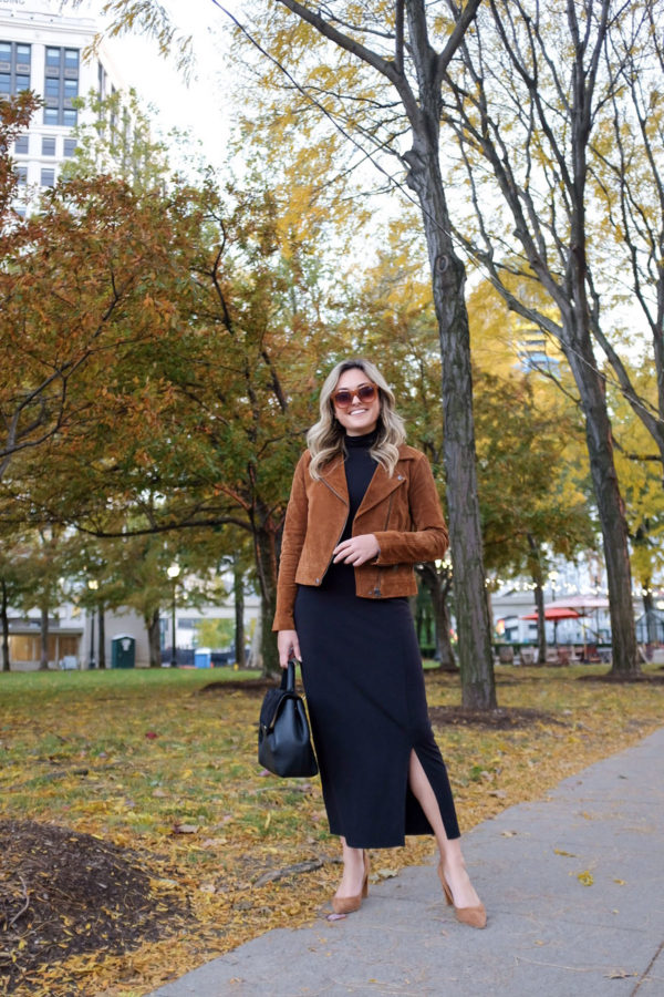 Lifestyle blogger Jessica Sturdy of Bows & Sequins styling a Blank NYC cognac suede moto jacket with a black turtleneck midi dress in the fall.